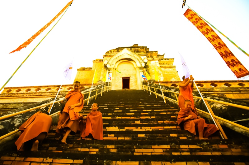 monks praying at a monastery in Chaing Mai, Thailand.